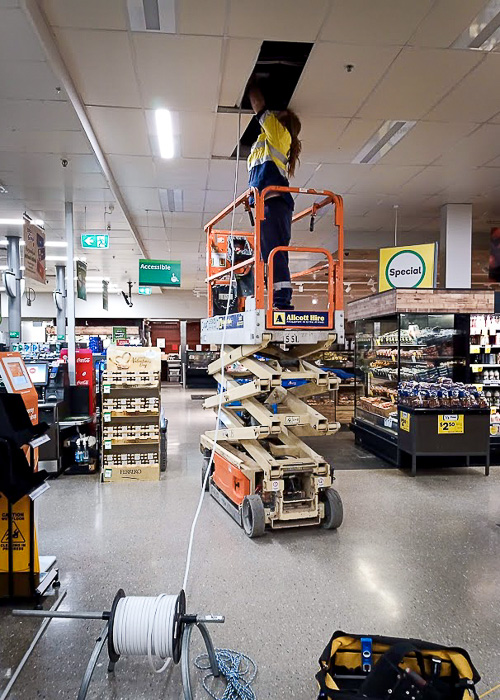 Daniel on scissor used by Melba Electrical Services