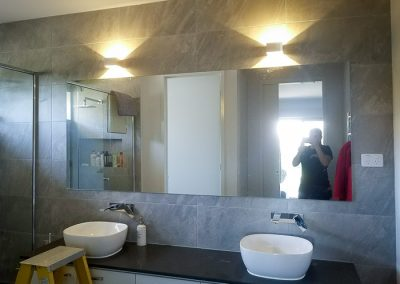 Amy from Melba Electrical Services installing New bathroom lighting